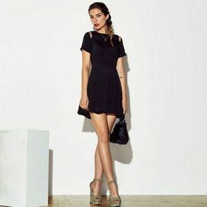 Reformation Felix mini dress in black size 4